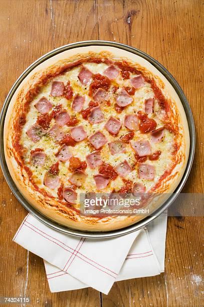 Ham, cheese and tomato pizza