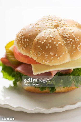 Ham, cheese, tomato and gherkin in sesame roll : Stock Photo