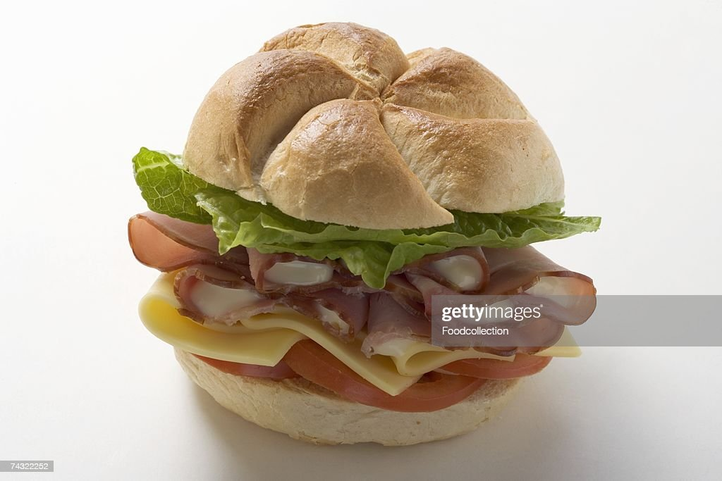 Ham, cheese, tomato and lettuce in a bread roll : Stock Photo