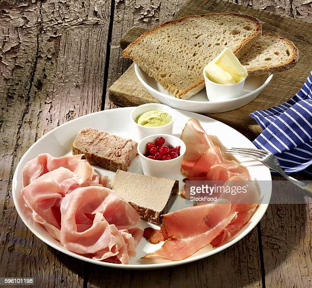 Ham platter with pâté, bread and butter
