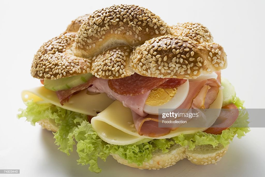 Ham, salami, cheese and egg sandwich : Stock Photo