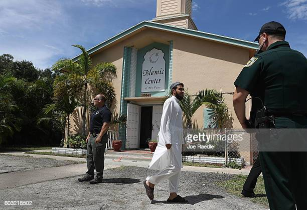 Hamaad Rahman whose father is an Imam of the Islamic Center of Fort Pierce arrives to speak to the media as Law enforcement officials investigate a...