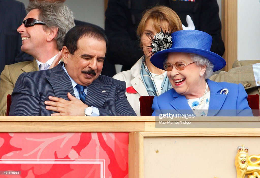 Hamad bin Isa Al-Khalifa, King of Bahrain and Queen <a gi-track='captionPersonalityLinkClicked' href=/galleries/search?phrase=Elizabeth+II&family=editorial&specificpeople=67226 ng-click='$event.stopPropagation()'>Elizabeth II</a> watch the Services Team Jumping Event from the Royal Box on day 4 of the Royal Windsor Horse Show at Home Park on May 17, 2014 in Windsor, England.