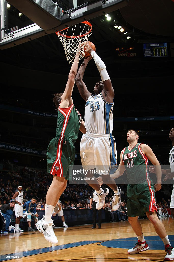 Hamady Ndiaye #55 of the Washington Wizards dunks against <a gi-track='captionPersonalityLinkClicked' href=/galleries/search?phrase=Andrew+Bogut&family=editorial&specificpeople=207105 ng-click='$event.stopPropagation()'>Andrew Bogut</a> #6 of the Milwaukee Bucks during the game at the Verizon Center on March 8, 2011 in Washington, DC.