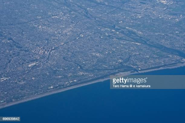 Hamamatsu city, Tenryu River and Pacific Ocean daytime aerial view from airplane