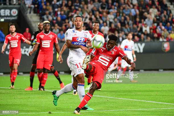 Hamari Traore of Rennes and Memphis Depay of Lyon during the Ligue 1 match between Stade Rennais and Olympique Lyonnais at Roazhon Park on August 11...