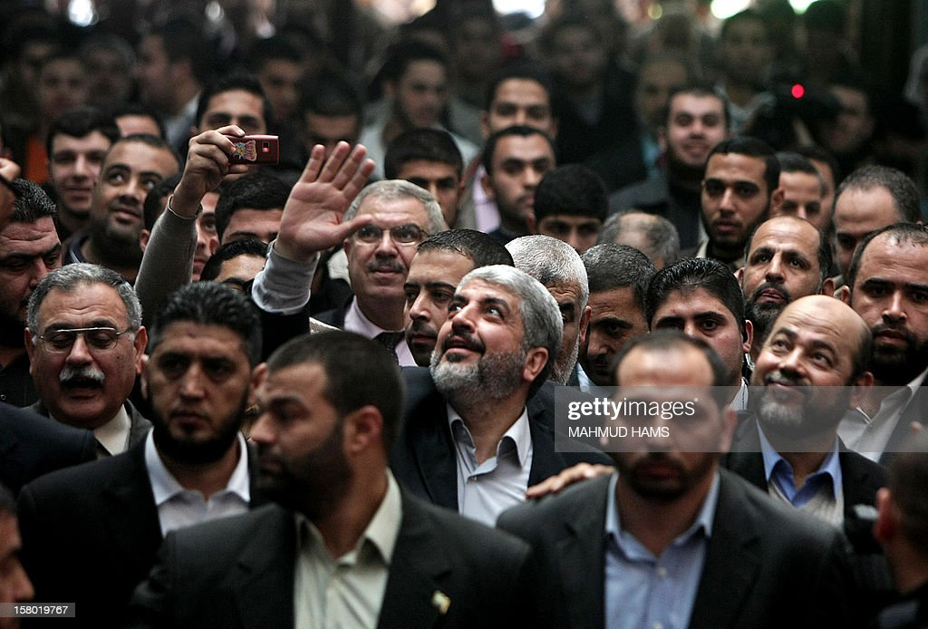 Hamas chief in exile Khaled Meshaal (C) waves at supporters during a visit to the Islamic University in Gaza City on December 9, 2012. Meshaal rejected ceding 'an inch' of Palestinian territory to Israel or recognising the Jewish state, in a speech in Gaza where he is on a historic first visit.