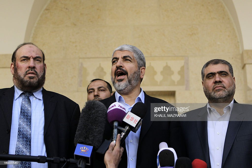 Hamas chief Khaled Meshaal (C) and members of Hamas' political bureau, Mohammed Nazzal (L) and Mohammed Nasser (R) speak to reporters flowing their meeting with Jordan's King Abdullah II at the royal palace in Amman on January 28, 2013. Hamas chief is holding talks with Jordan's King over Palestinian reconciliation efforts.