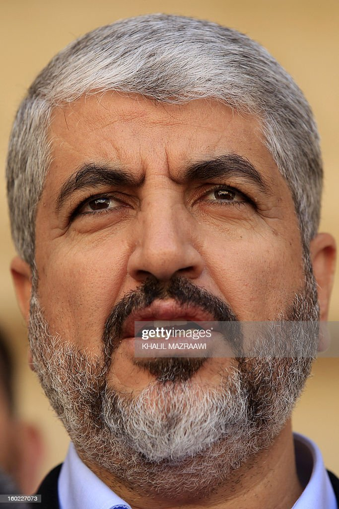 Hamas chief Khaled Meshaal speaks to reporters flowing his meeting with Jordan's King Abdullah II at the royal palace in Amman on January 28, 2013. Hamas chief is holding talks with Jordan's King over Palestinian reconciliation efforts. AFP PHOTO/KHALIL MAZRAAWI