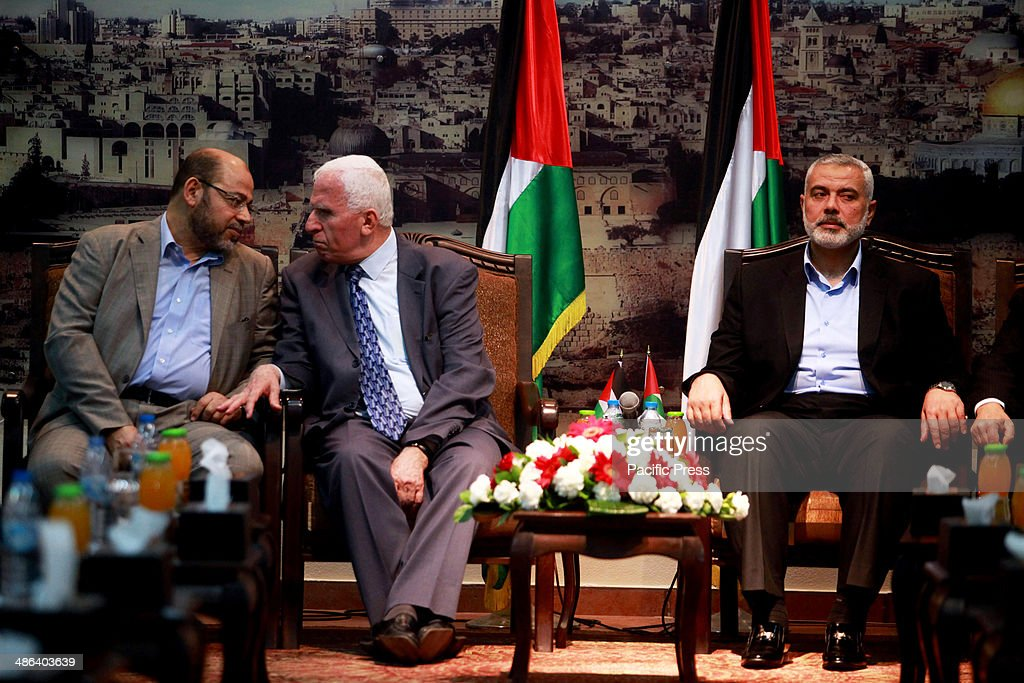 Hamas deputy leader Musa Abu Marzuk speaks with the head of the delegation of the Palestine Liberation Organisation Azzam alAhmad a senior figure in...
