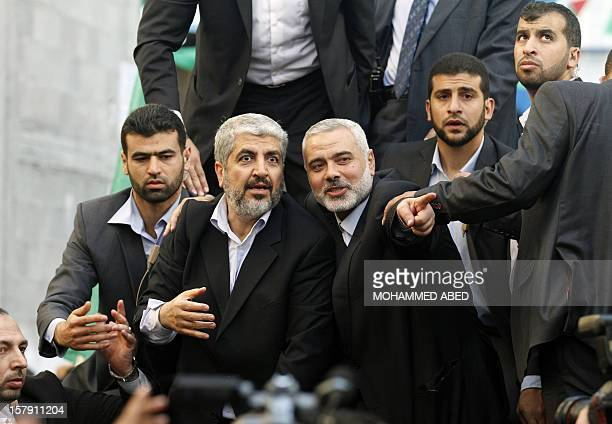 Hamas government prime minister in Gaza Ismail Haniya points something out to Hamas leaderinexile Khaled Meshaal as they parade the streets from the...