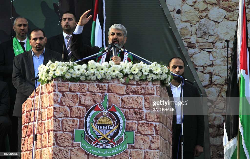 Hamas leader in exile Khaled Meshaal delivers a speech to Hamas supporters during a rally to mark the 25th anniversary of the founding of the Islamist movement, in Gaza City on December 8, 2012. Meshaal made his first visit to Gaza, timed to coincide with the 25th anniversary of the Islamist movement's founding. AFP PHOTO/ SAID KHATIB