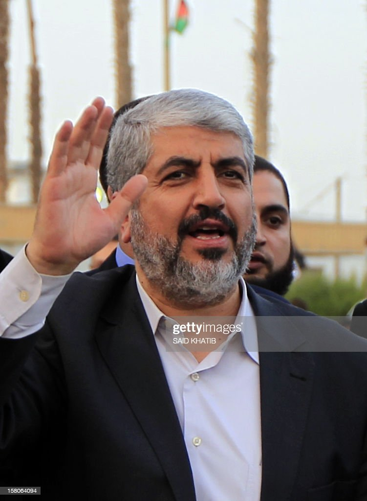 Hamas leader in exile Khaled Meshaal waves goodbye upon his departure from the Gaza Strip on December 10, 2012 in Rafah, on the border with Egypt. Exiled Hamas chief Khaled Meshaal left Gaza after a historic first visit to the tiny Palestinian enclave. AFP PHOTO/ SAID KHATIB