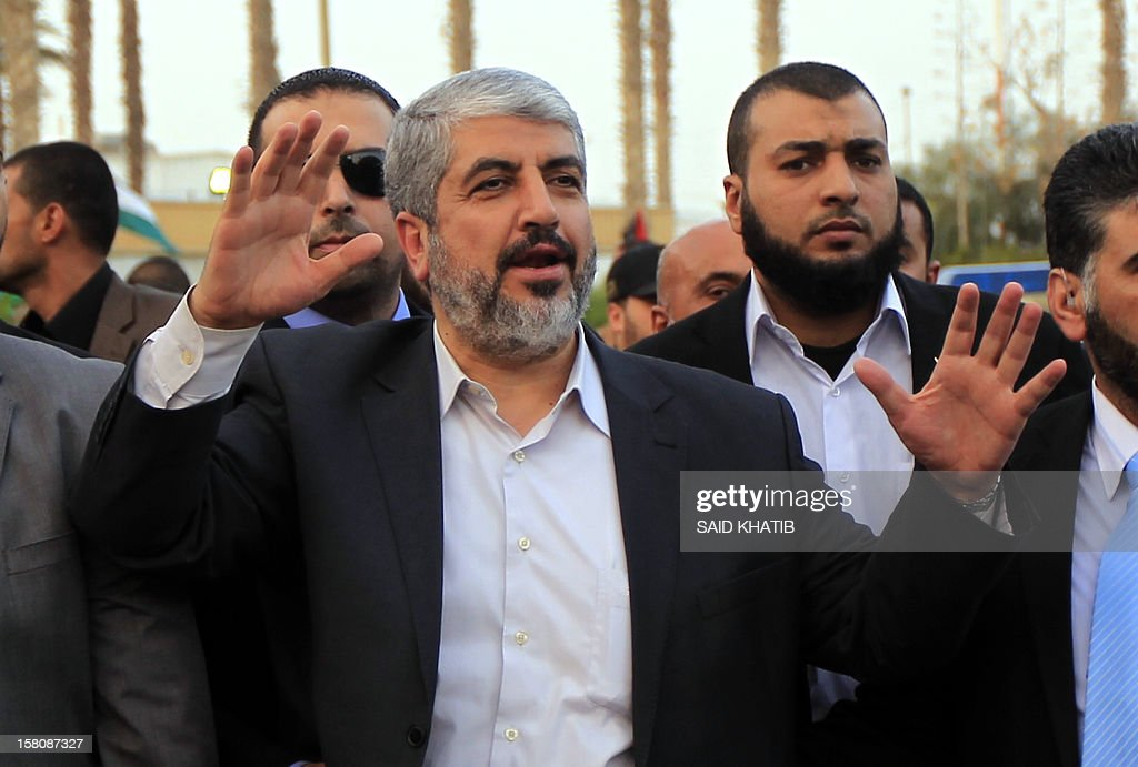 Hamas leader in exile Khaled Meshaal waves goodbye upon his departure from the Gaza Strip on December 10, 2012 in Rafah, on the border with Egypt. Exiled Hamas chief Khaled Meshaal left Gaza after a historic first visit to the tiny Palestinian enclave.