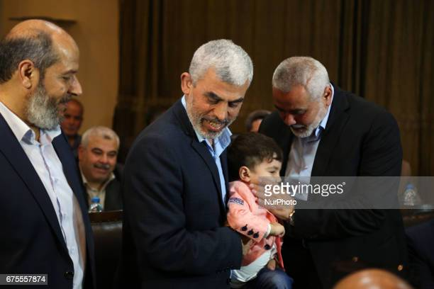 Hamas leader Ismail Haniyeh and Hamas Gaza Chief Yehya AlSinwar attend a ceremony announcing a new policy document in Gaza City May 1 2017