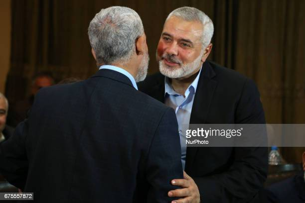 Hamas leader Ismail Haniyeh kisses Hamas Gaza Chief Yehya AlSinwar during a ceremony announcing a new policy document in Gaza City May 1 2017
