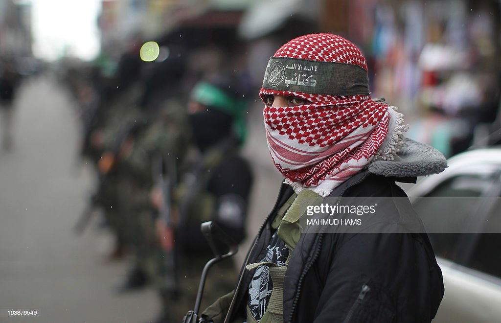 A Hamas militant takes part in the funeral procession for Hamas militant and lawmaker Mariam Farahat in Gaza City on March 17, 2013. Farhat, who was known for losing three of her militant sons to suicide bombings and Israeli military attacks, died after a long-term illness. AFP PHOTO MAHMUD HAMS