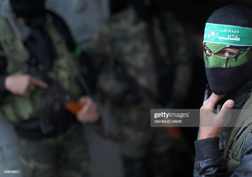 A Hamas militant takes part in the funeral procession for Hamas militant and lawmaker Mariam Farahat in Gaza City on March 17, 2013. Farhat, who was known for losing three of her militant sons to suicide bombings and Israeli military attacks, died after a long-term illness.