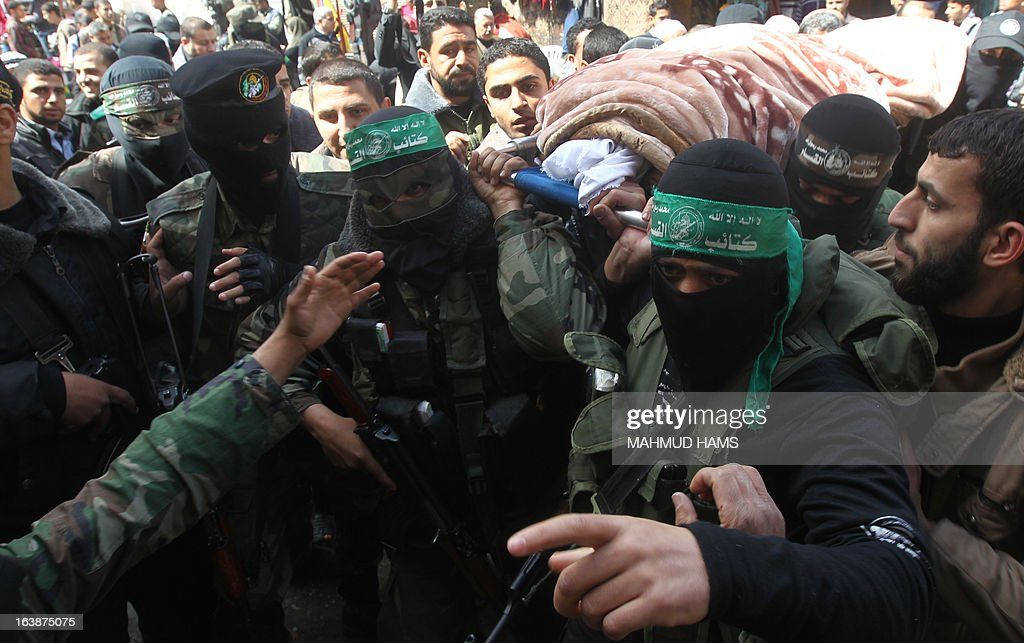 Hamas militants carry the body of a Hamas militant, lawmaker Mariam Farahat during her funeral at al-Omari Mosque in Gaza City on March 17, 2013. Farhat, who was known for losing three of her militant sons to suicide bombings and Israeli military attacks, died after a long-term illness. AFP PHOTO MAHMUD HAMS