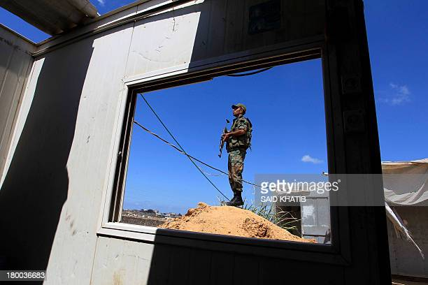 A Hamas policeman stands guard along the border with Egypt and the Palestinian territory on September 8 2013 in the southern Gaza Strip city of Rafah...