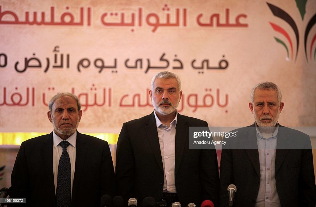 Hamas Political Bureau Vice President <a gi-track='captionPersonalityLinkClicked' href=/galleries/search?phrase=Ismail+Haniyeh&family=editorial&specificpeople=543410 ng-click='$event.stopPropagation()'>Ismail Haniyeh</a> (C), one of Hamas' leaders <a gi-track='captionPersonalityLinkClicked' href=/galleries/search?phrase=Mahmoud+al-Zahar&family=editorial&specificpeople=606128 ng-click='$event.stopPropagation()'>Mahmoud al-Zahar</a> (L) and member of the Political Bureau of the Islamic Jihad Movement Mohamed al-Hindi (R) attend the '9th Conference on the Protection of the Inalienable Parts of Palestine' organized for 'Palestine Land Day'.