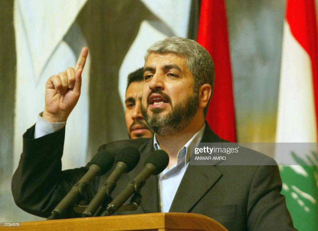 Hamas political leader <a gi-track='captionPersonalityLinkClicked' href=/galleries/search?phrase=Khaled+Mashaal&family=editorial&specificpeople=558224 ng-click='$event.stopPropagation()'>Khaled Mashaal</a> delivers a speech 16 November 2003 during a ceremony in Beirut to mark 33 years since deceased al-Assad swept to power in Syria. The Shiite fundamentalist and militant Palestinian groups Hezbollah and Hamas dismissed recent military exercises carried out by Israel on its borders with Lebanon and Syria as a 'media' ploy. The Israeli army said Thursday that it had this week started large-scale exercises near the Jewish state's border with Lebanon and the ceasefire line with Syria. AFP PHOTO/Anwar AMRO