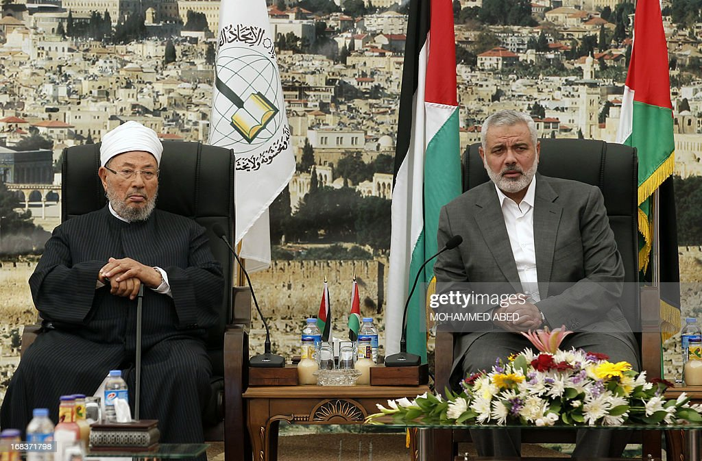 Hamas Prime Minister Ismail Haniyeh (R) meets with Egyptian Cleric and chairman of the International Union of Muslim Scholars Sheikh Yusuf al-Qaradawi (L) after the latter's arrival in Gaza City on May 9, 2013. Al-Qaradawi arrived on May 8, 2013 for his first visit to Gaza Strip with a delegation of Muslim scholars.