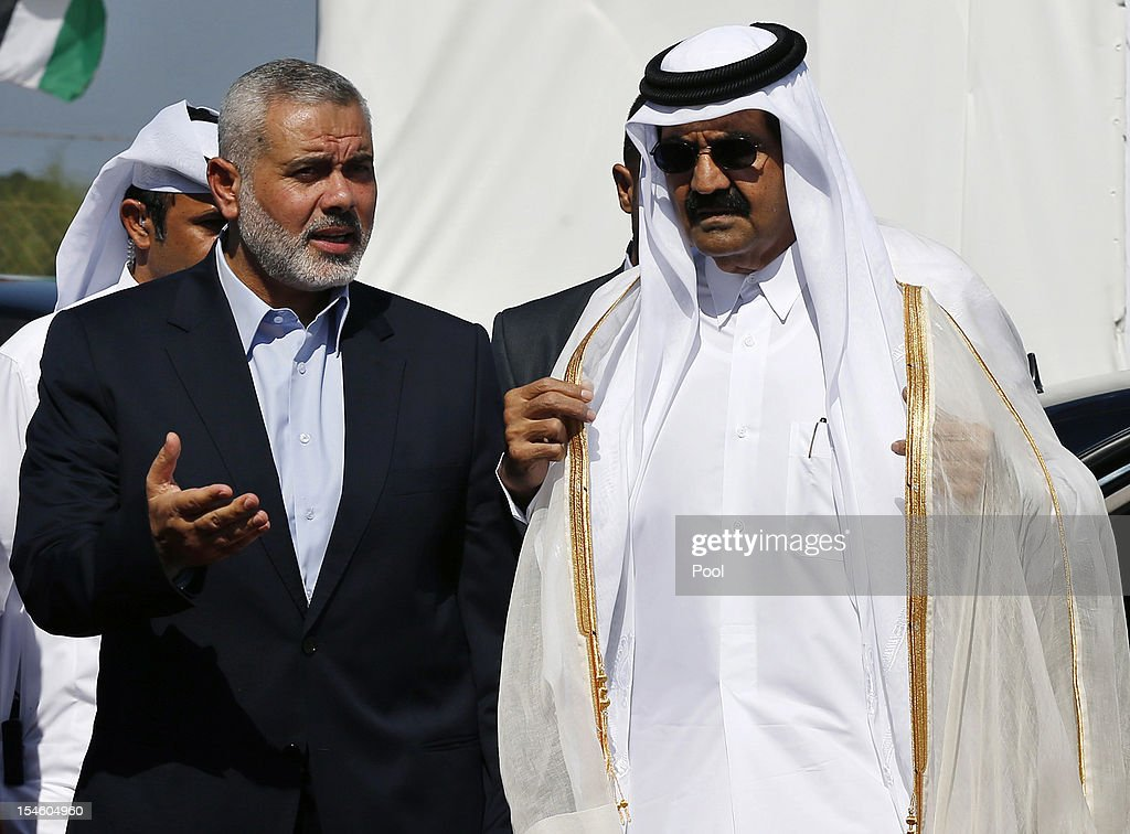 Hamas Prime Minister <a gi-track='captionPersonalityLinkClicked' href=/galleries/search?phrase=Ismail+Haniyeh&family=editorial&specificpeople=543410 ng-click='$event.stopPropagation()'>Ismail Haniyeh</a> (L) of the Palestinian National Authority and the Emir of Qatar Sheikh Hamad bin Khalifa al-Thani arrive to a cornerstone-laying ceremony for Hamad, a new residential neighbourhood October 23, 2012 in Khan Younis in the southern Gaza Strip. The Emir of Qatar embraced the Hamas leadership of Gaza with an official visit, breaking the isolation of the militant Palestinian Islamist movement, to the dismay of Israel and rival, Western-backed Palestinian leaders in the West Bank.