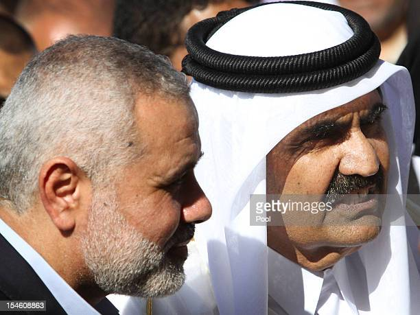 Hamas Prime Minister Ismail Haniyeh of the Palestinian National Authority and the Emir of Qatar Sheikh Hamad bin Khalifa alThani arrive to a...