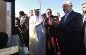 Hamas Prime Minister Ismail Haniyeh of the Palestinian National Authority the Emir of Qatar Sheikh Hamad bin Khalifa alThani and his wife Sheikha...