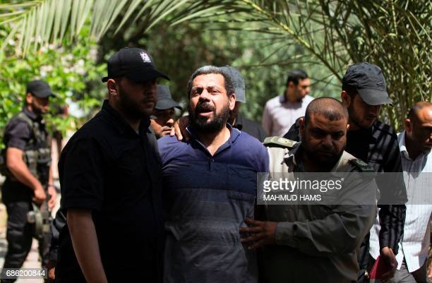 Hamas security forces escort Hisham alAloul a 44yearold Palestinian man convicted of the murder of Hamas military commander Mazen Faqha out of the...