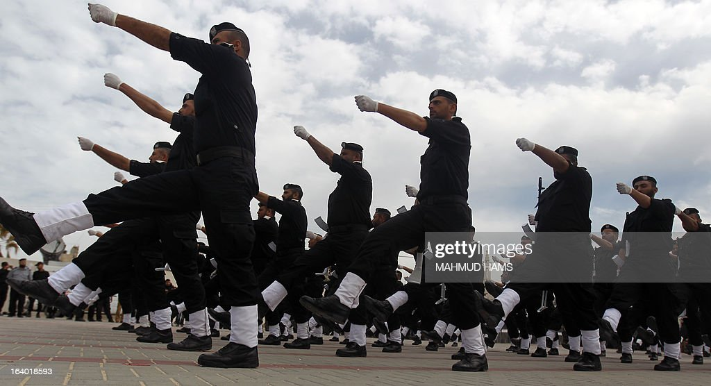 Hamas security forces march during their graduation ceremony in Gaza City on March 19, 2013. AFP PHOTO/MAHMUD HAMS