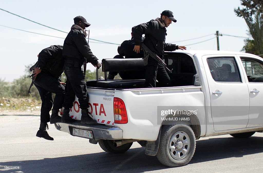 Hamas security men arrive at their post on the border between Gaza city and Israel to prevent any Palestinian collaborators from escaping to Israel on April 10, 2013. Hamas accused Western and Arab spy agencies of operating in the Gaza Strip and said it had a list of alleged collaborators.