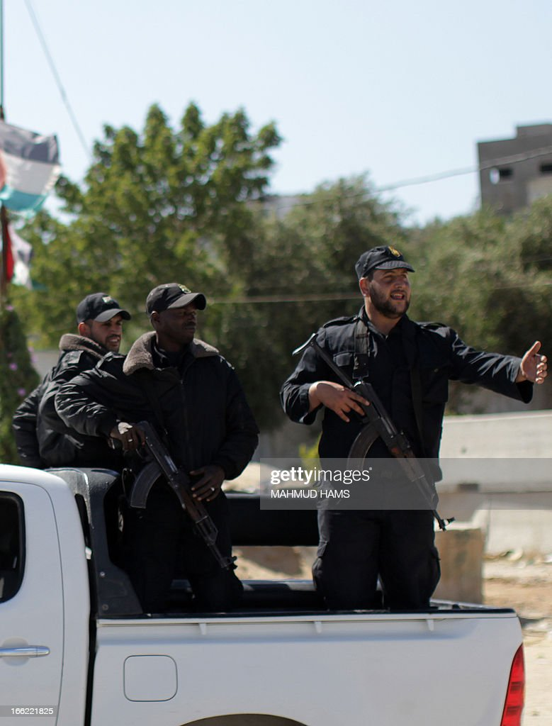Hamas security men stand guard on the border between Gaza city and Israel to prevent any Palestinian collaborators from escaping to Israel on April 10, 2013. Hamas accused Western and Arab spy agencies of operating in the Gaza Strip and said it had a list of alleged collaborators.