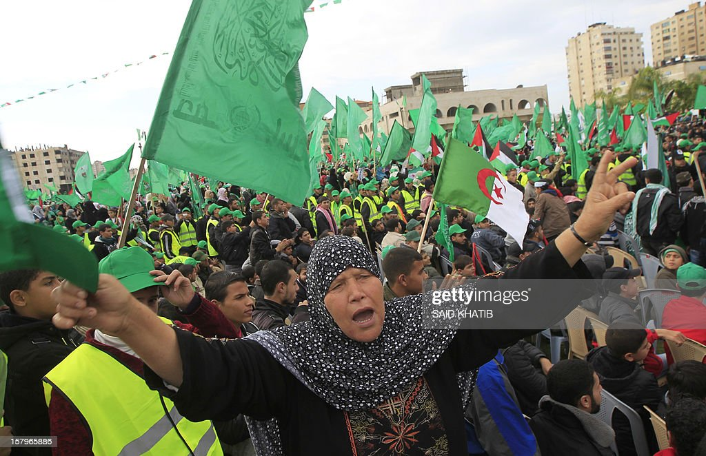 A Hamas supporter attends a rally to mark the 25th anniversary of the founding of the Islamist movement, in Gaza City on December 8, 2012. Hamas leader in exile Khaled Meshaal made his first visit to Gaza, timed to coincide with the 25th anniversary of the Islamist movement's founding.