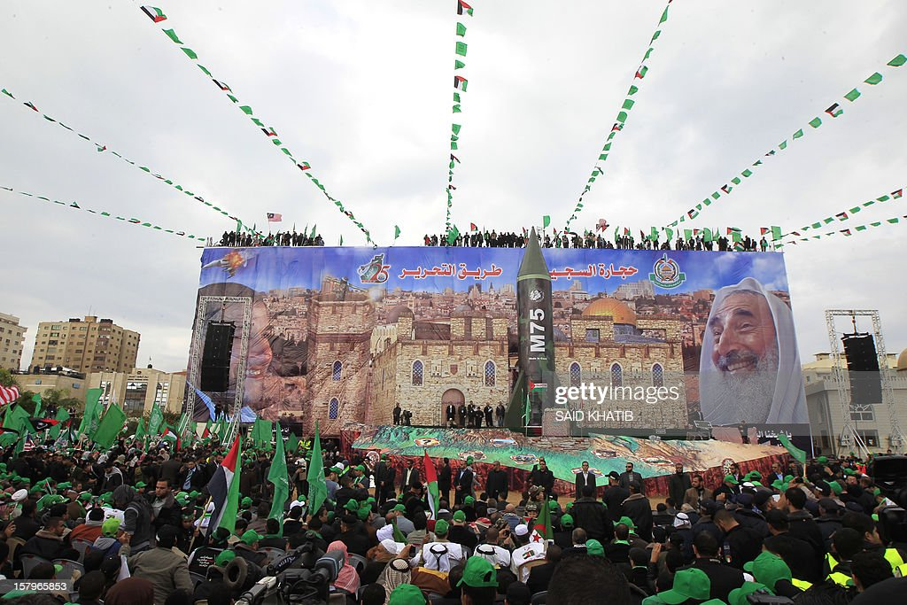 Hamas supporters attend a rally to mark the 25th anniversary of the founding of the Islamist movement, in Gaza City on December 8, 2012. Hamas leader in exile Khaled Meshaal made his first visit to Gaza, timed to coincide with the 25th anniversary of the Islamist movement's founding. AFP PHOTO/ SAID KHATIB