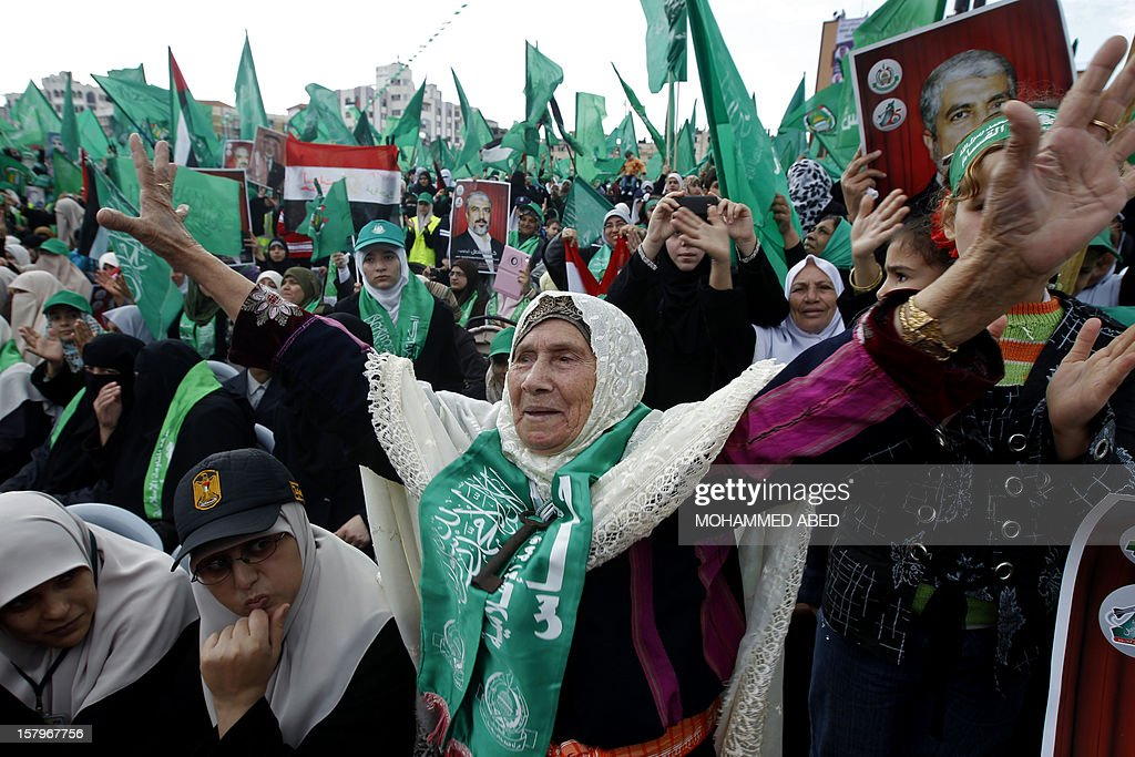 Hamas supporters attend a rally to mark the 25th anniversary of the founding of the Islamist movement, in Gaza City on December 8, 2012. More than 100,000 Palestinians gathered in Gaza for the rally to mark the occasion during which Hamas leader in exile Khaled Meshaal delivered a speech.