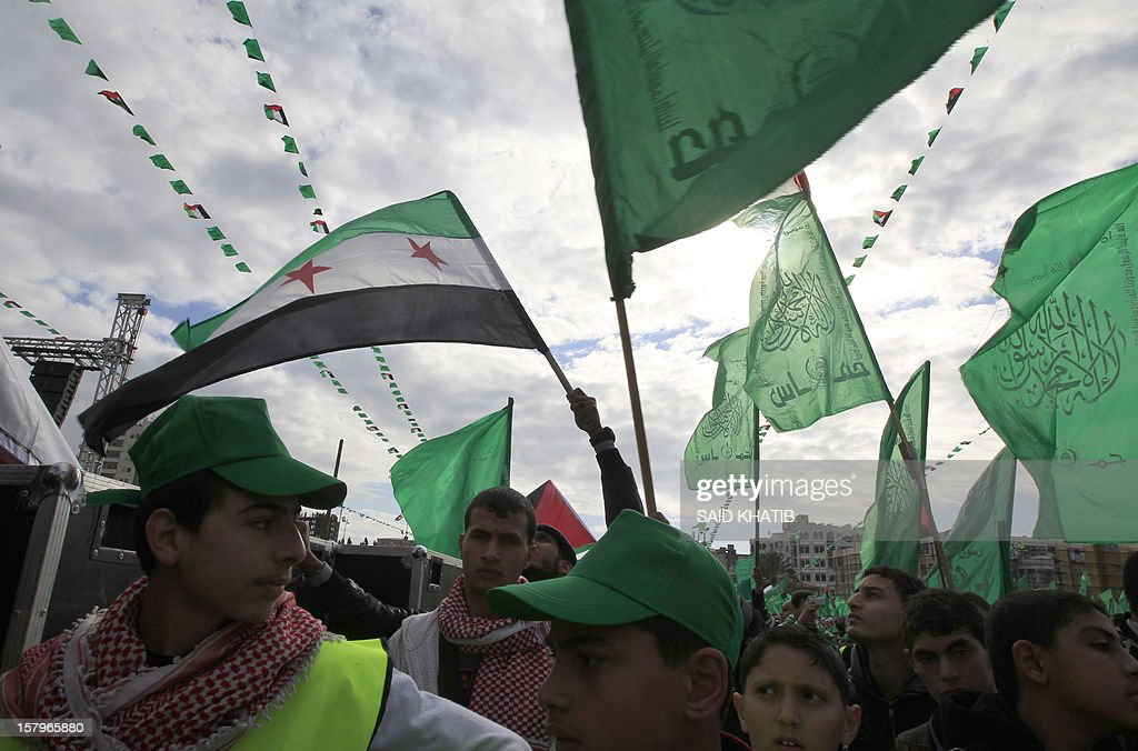 Hamas supporters hold up the movement's green flag during a rally to mark the 25th anniversary of the founding of the Islamist movement, in Gaza City on December 8, 2012. Hamas leader in exile Khaled Meshaal made his first visit to Gaza, timed to coincide with the 25th anniversary of the Islamist movement's founding.