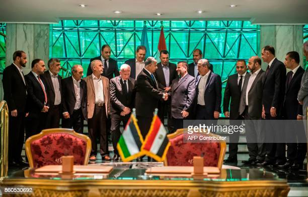 Hamas's new deputy leader Salah alAruri shakes hands with Khaled Fawzi the head of the Egyptian Intelligence services after the signing of a...