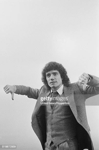 Hamburg and England footballer Kevin Keegan gives a thumbs down signal to spectators at Wembley stadium before the cancellation of the International...