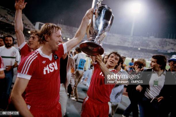 SV Hamburg captain Horst Hrubesch parades the European Cup around the Olympic Stadium in Athens with winning goalscorer Felix Magath