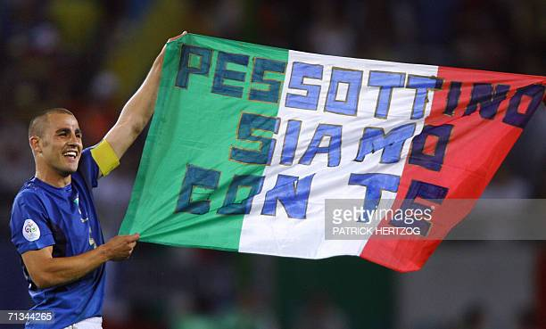 Italian defender Fabio Cannavaro holds a banner reading 'Pessotto we are with you' in honour to the former Juventus player Gianluca Pessotto who...
