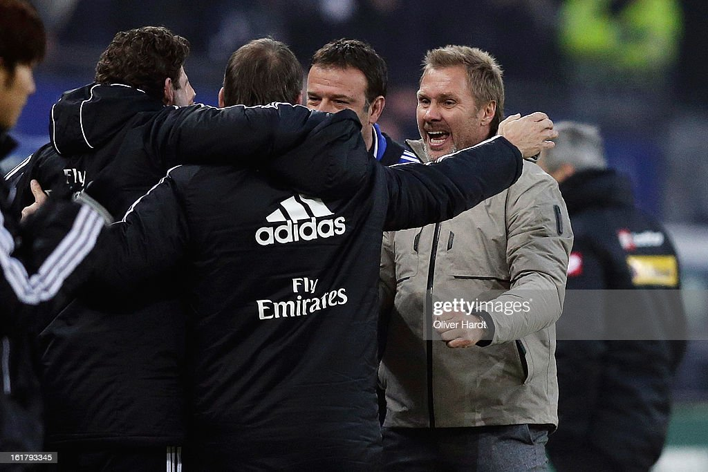 Hamburg head coach <a gi-track='captionPersonalityLinkClicked' href=/galleries/search?phrase=Thorsten+Fink&family=editorial&specificpeople=2381735 ng-click='$event.stopPropagation()'>Thorsten Fink</a> (R) and staff celebrate after the Bundesliga match between Hamburger SV and Borussia Moenchengladbach at Imtech Arena on February 16, 2013 in Hamburg, Germany.