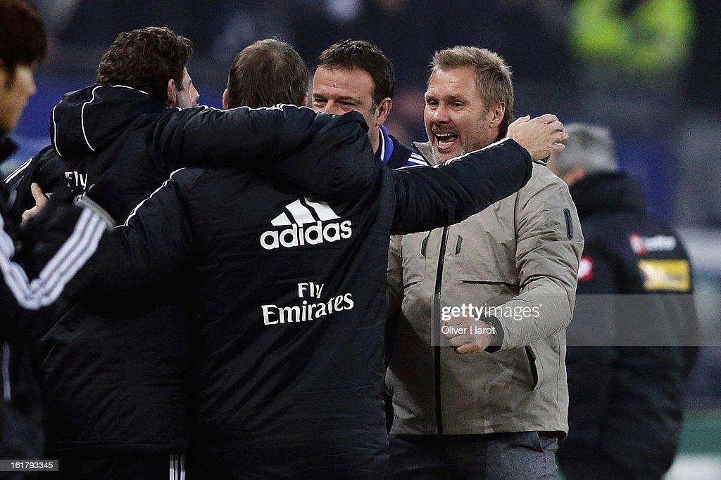 Hamburg head coach Thorsten Fink (R) and staff celebrate after the Bundesliga match between Hamburger SV and Borussia Moenchengladbach at Imtech Arena on February 16, 2013 in Hamburg, Germany.