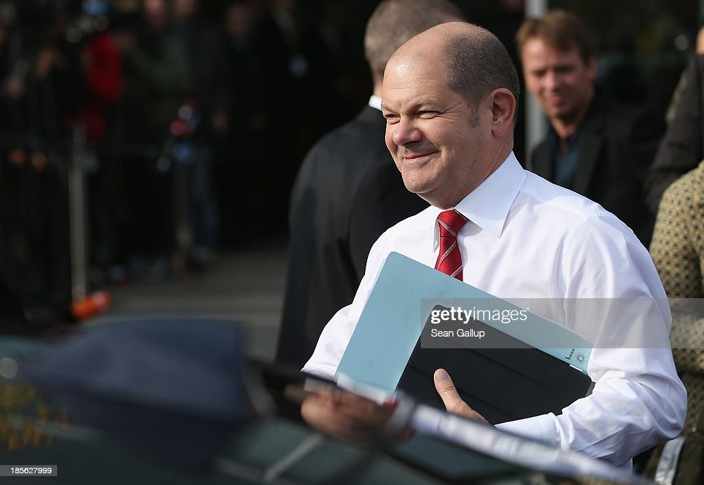 Hamburg Mayor <a gi-track='captionPersonalityLinkClicked' href=/galleries/search?phrase=Olaf+Scholz&family=editorial&specificpeople=2162609 ng-click='$event.stopPropagation()'>Olaf Scholz</a> of the German Social Democrats (SPD) arrives for coalition negotiations at the headquarters of the German Christian Democrats (CDU) on October 23, 2013 in Berlin, Germany. The CDU and SPD are meeting for the first day of negotiations in order to create a new coalition government following recent elections in Germany.