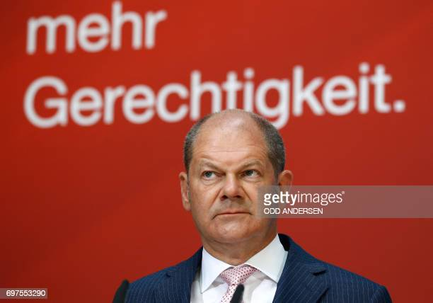 Hamburg SPD's mayor Olaf Scholz attends a press conference at SPD's headquarters on June 19 2017 in Berlin / AFP PHOTO / Odd ANDERSEN