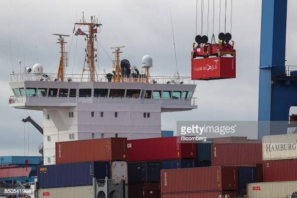 A Hamburg Sued shipping container is loaded on to the OOCL Rauma container ship operated by JR Ship Management BV at the Port of Hamburg in Hamburg...
