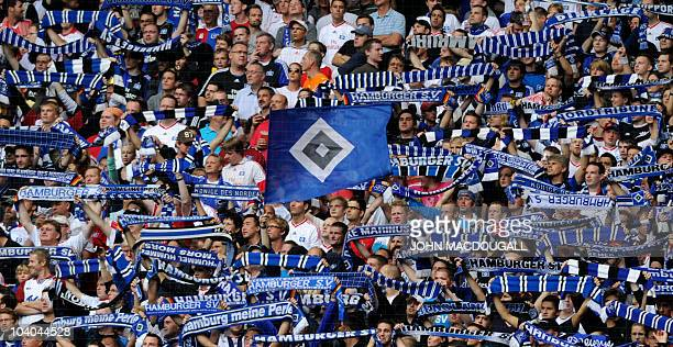 DFL Hamburg supporter sing their team's anthem pror to the start of the German first division Bundesliga football match Hamburg SV vs 1 FC Nuremberg...