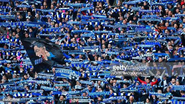 Hamburg supporters display their scarves prior to the German First division Bundesliga football match between Hamburg SV and Hertha Berlin on March 5...