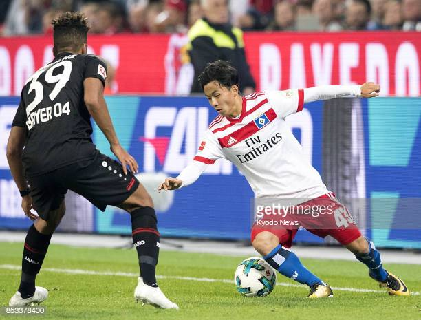 Hamburg SV's Tatsuya Ito vies for the ball during a match against Bayer Leverkusen at Bay Arena in Leverkusen Germany on Sept 24 on his longawaited...